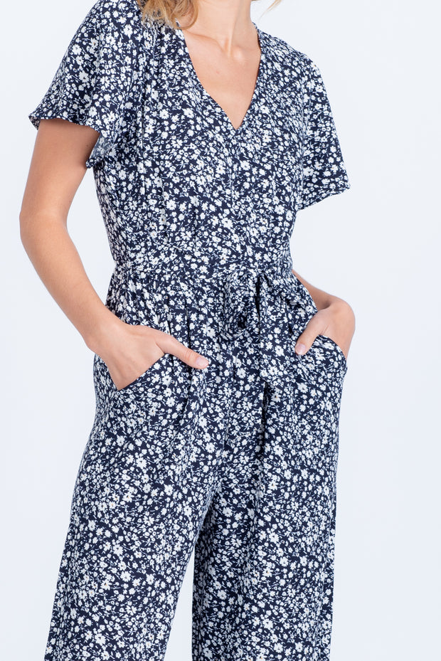 BE THE CHANGE NAVY SHORT SLEEVE FLORAL JUMPSUIT