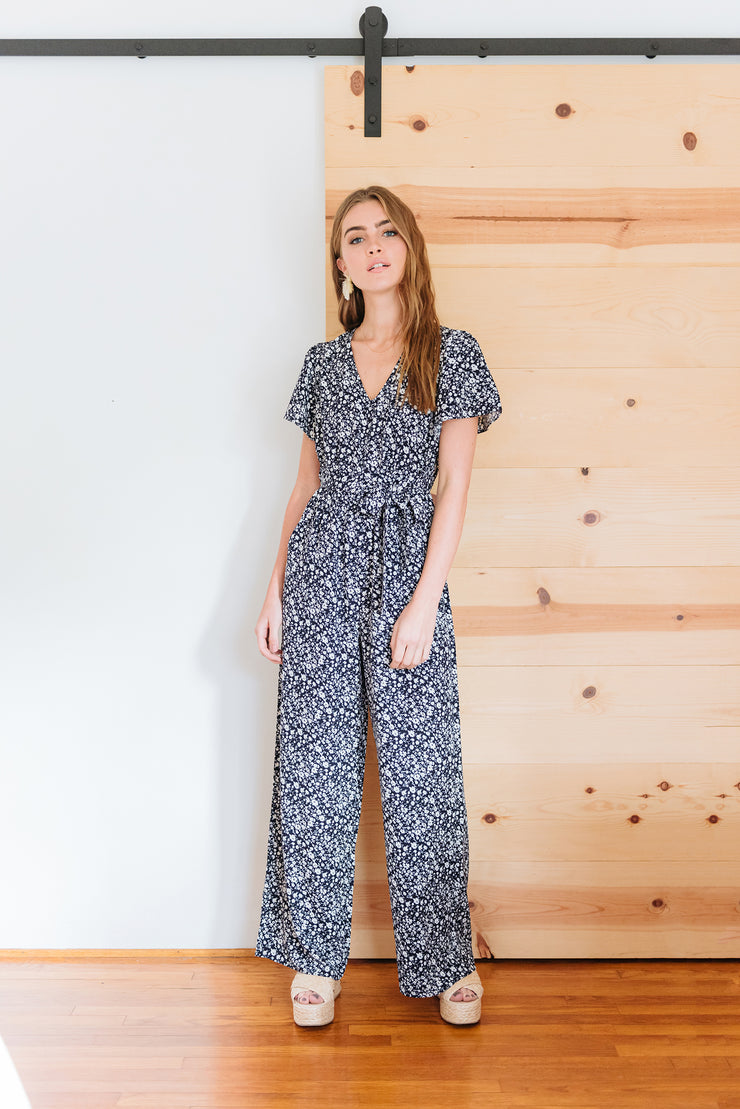 BE THE CHANGE SHORT SLEEVE FLORAL JUMPSUIT