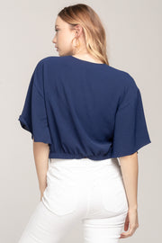 KNOT SURPRISED FLARE SLEEVE KNOTTED CROP TOP