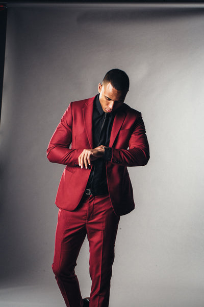 Good looking African American man in black tailored shirt and custom made red suit