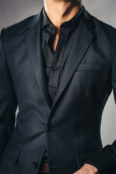 Close up pic of all black custom made suit and tailored shirt