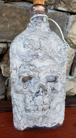 Small Stone Skull Face Bottle