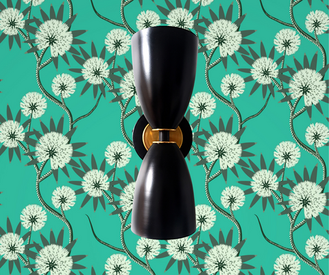 Green wallpaper with black sconce