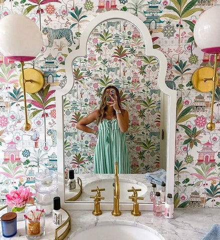 Floral Bathroom wallpaper with Verbena Sconces and a white arched mirror
