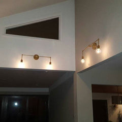 brass accent lighting high ceilings