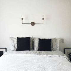 chrome light fixture over bed