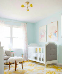 Pastel nursery design with a yellow and white Daisy Loa Ceiling Fixture