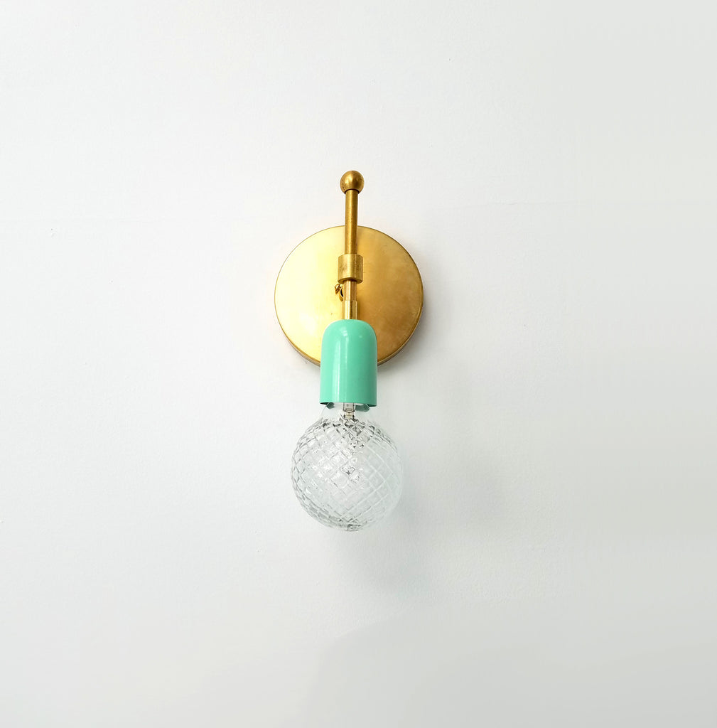brass and turquoise wall sconce