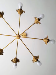 Brass floral chandelier mixes Victorian details with modern lines
