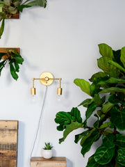 small magazine wall sconce brass lighting midcentury modern inspired