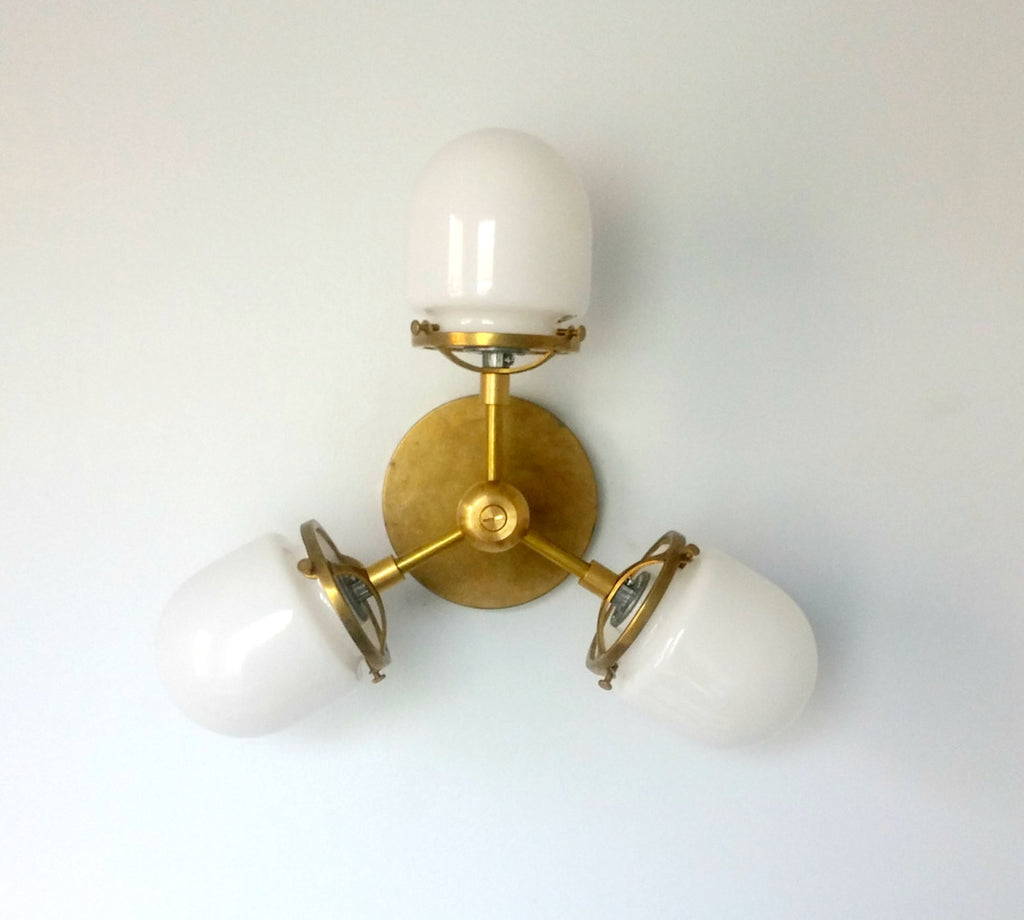 modern brass sconce with glass
