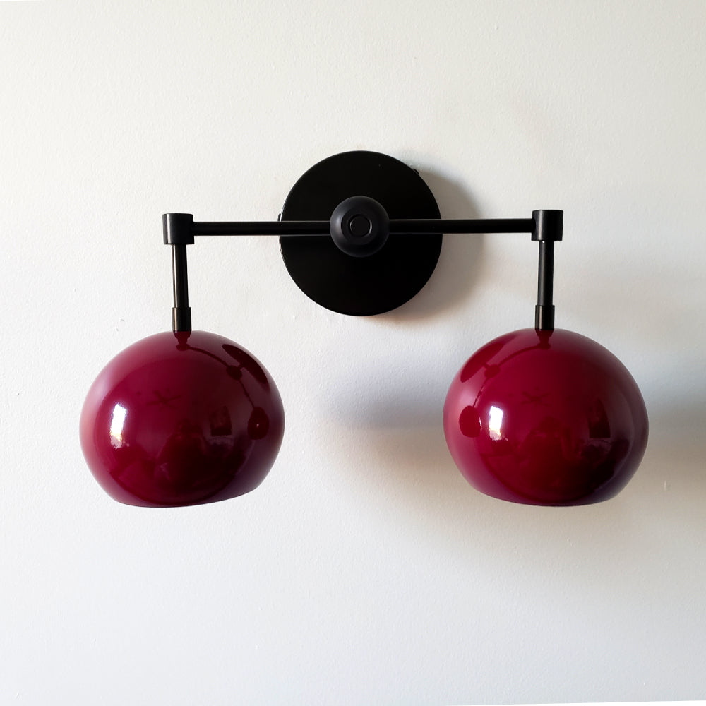 Dark purple and black mid century modern two light wall sconce for bathroom or kitchen renovations