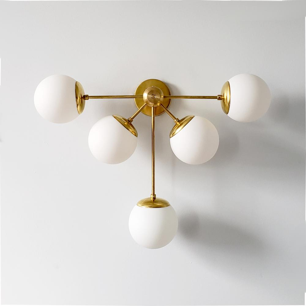 Brass Art Deco inspired oversized modern wall sconce