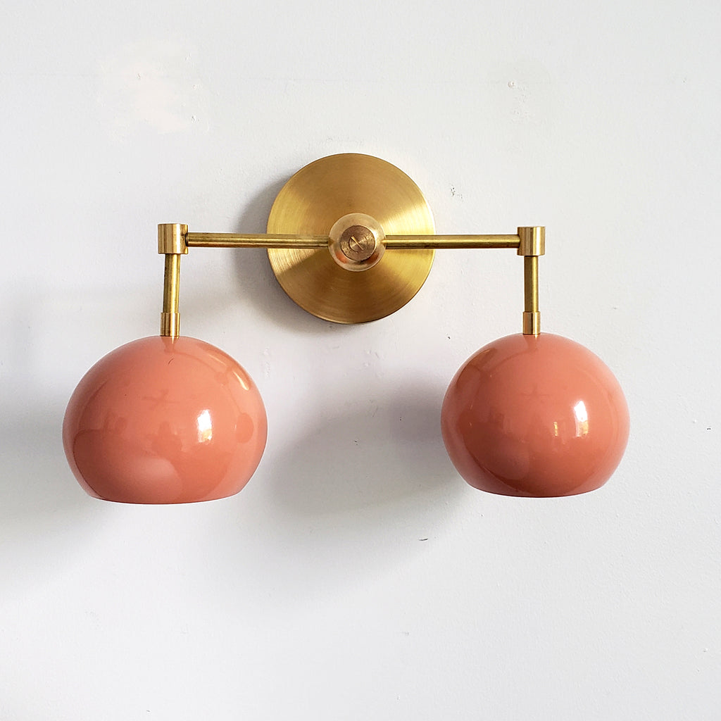 Brass and Peach Double Loa Sconce midcentury inspired modern lighting with boho flair
