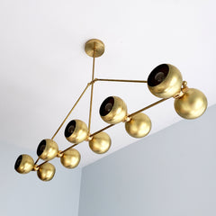 Brass modern chandelier with globe shades.  For oversized dining rooms or kitchen islands