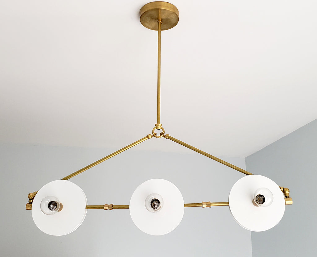 White and Brass Valerie chandelier by Sazerac Stitches - inspired by midcentury modern Italian design. features crisp brass and white finishes in a linear shape