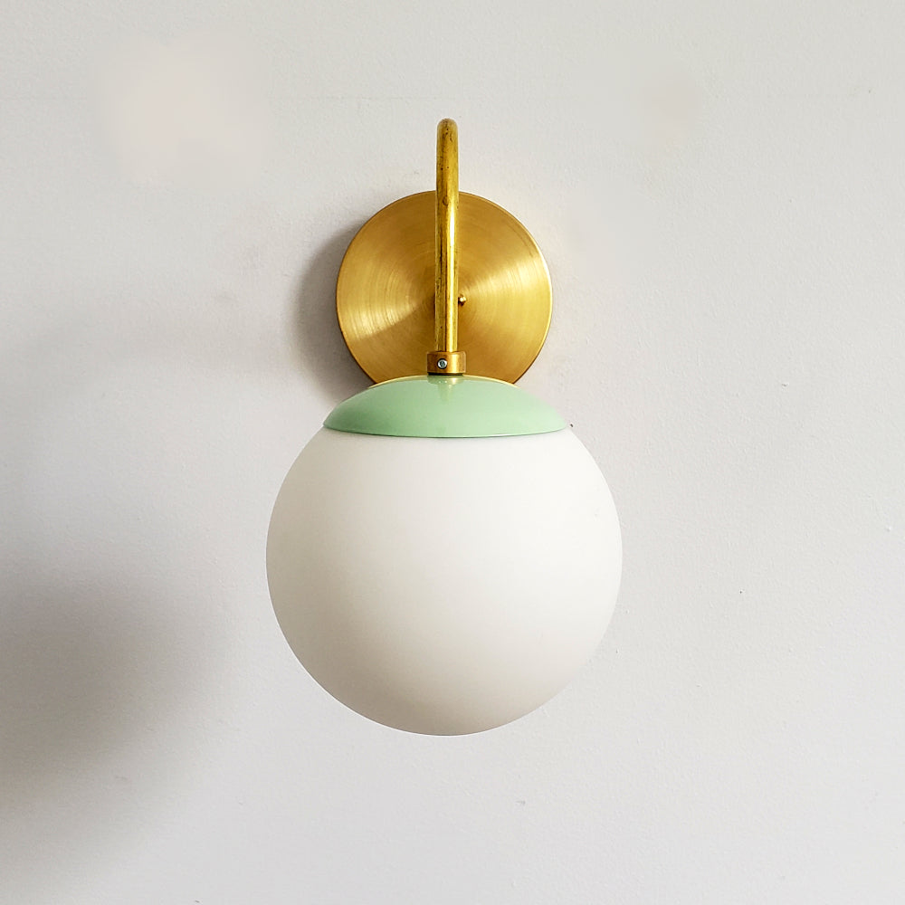 Brass and Mint Fontainebleau curved arm sconce modern design