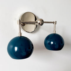 teal or lagoon blue two light wall sconce with mid century modern style is great for bathroom renovations
