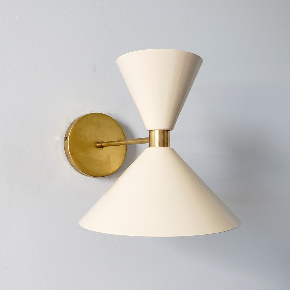 Cream and brass midcentury modern inspired cone wall sconce