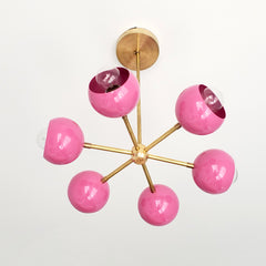 Pink and Brass mid century modern chandelier with globe shades