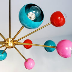 multicolored mid century modern sputnik style chandelier with pink orange and teal