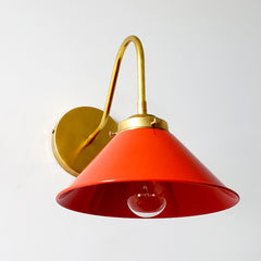Poppy red or flame orange wall sconce with brass hardware.  This colorful mid century modern style wall sconce is great for kitchens, bathrooms, bedrooms, etc.  Also fun for kids rooms.