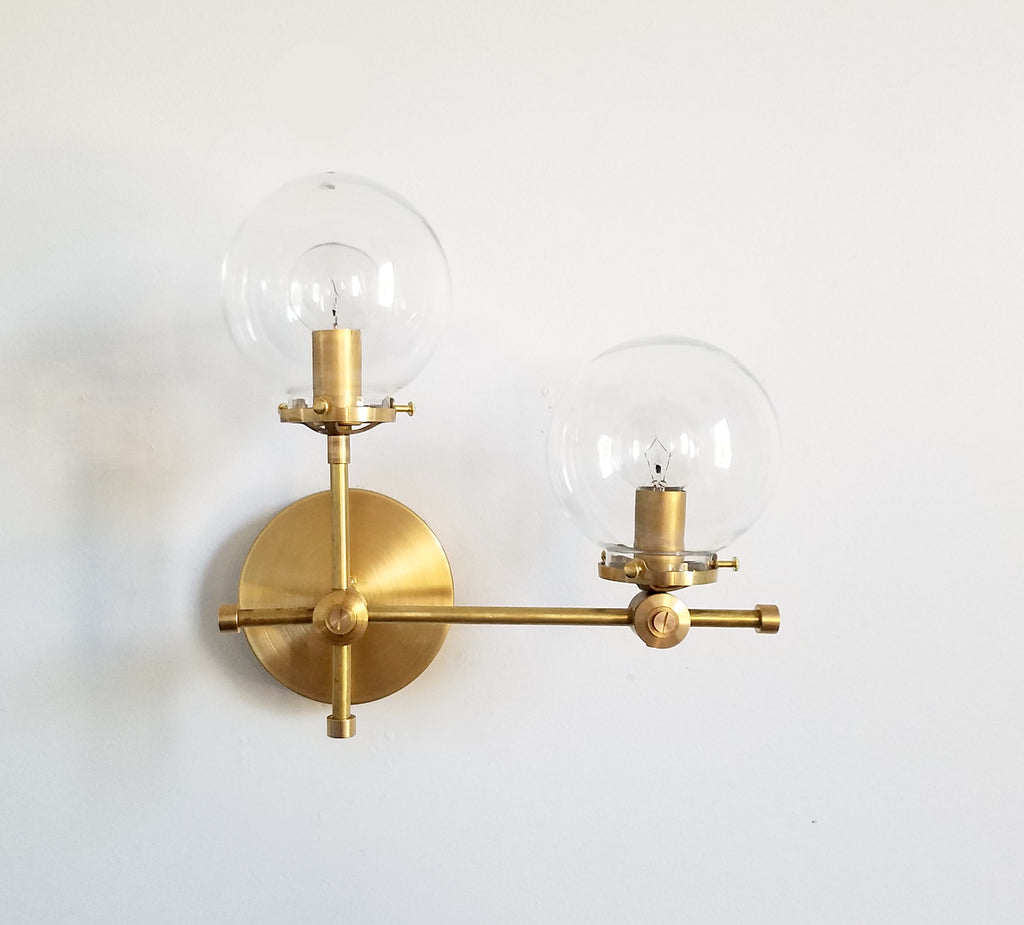 brass and clear glass globe L shaped wall sconce modernist midcentury modern contemporary wall lighting