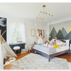 Modern chandelier in boys bedroom design with mountain and adventure theme