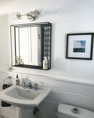 Chrome West End sconce with black square mirror in a bathroom remodel