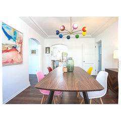 midcentury modern inspired dining room with bright colors and different colored chairs