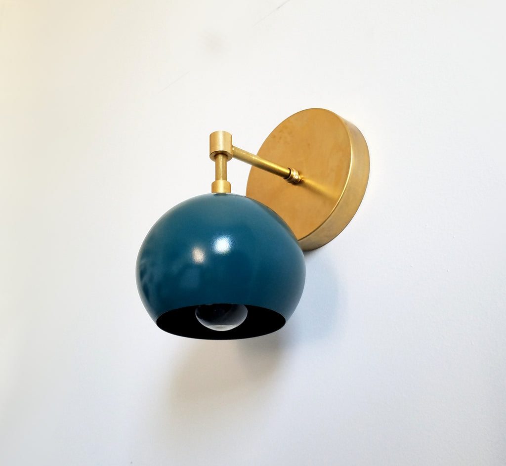 brass and teal mid century eyeball shade wall sconce