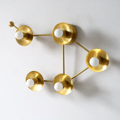 Brass Libra star sign wall sconce or flush-mount ceiling light in an asymmetric shape designed to look like stars - from the other side