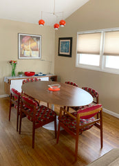 Midcentury modern dining room with accents of poppy red
