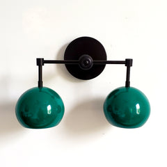 matte black and mermaid green two light wall sconce bathroom lighting