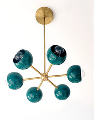 Bright green and brass orbit sputnik style pendant light chandelier with midcentury modern style and customizable colors