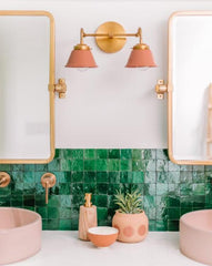 Peach and Brass Double Kelly Sconce features colorful shades and a raw brass finish modern bathroom lighting