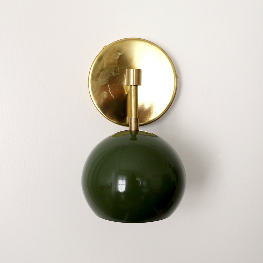 Olive green mid century modern globe wall sconce with brass hardware