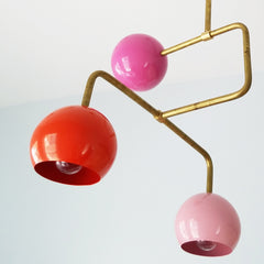 multicolored pink and gold mid century modern chandelier with colorful pink and orange globes