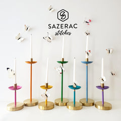Rainbow candle collection with white butterflies