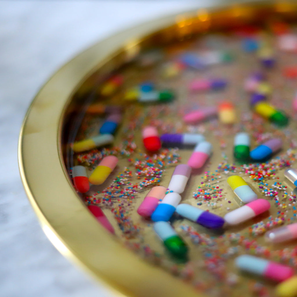 Gold tray with Sprinkles and Pills