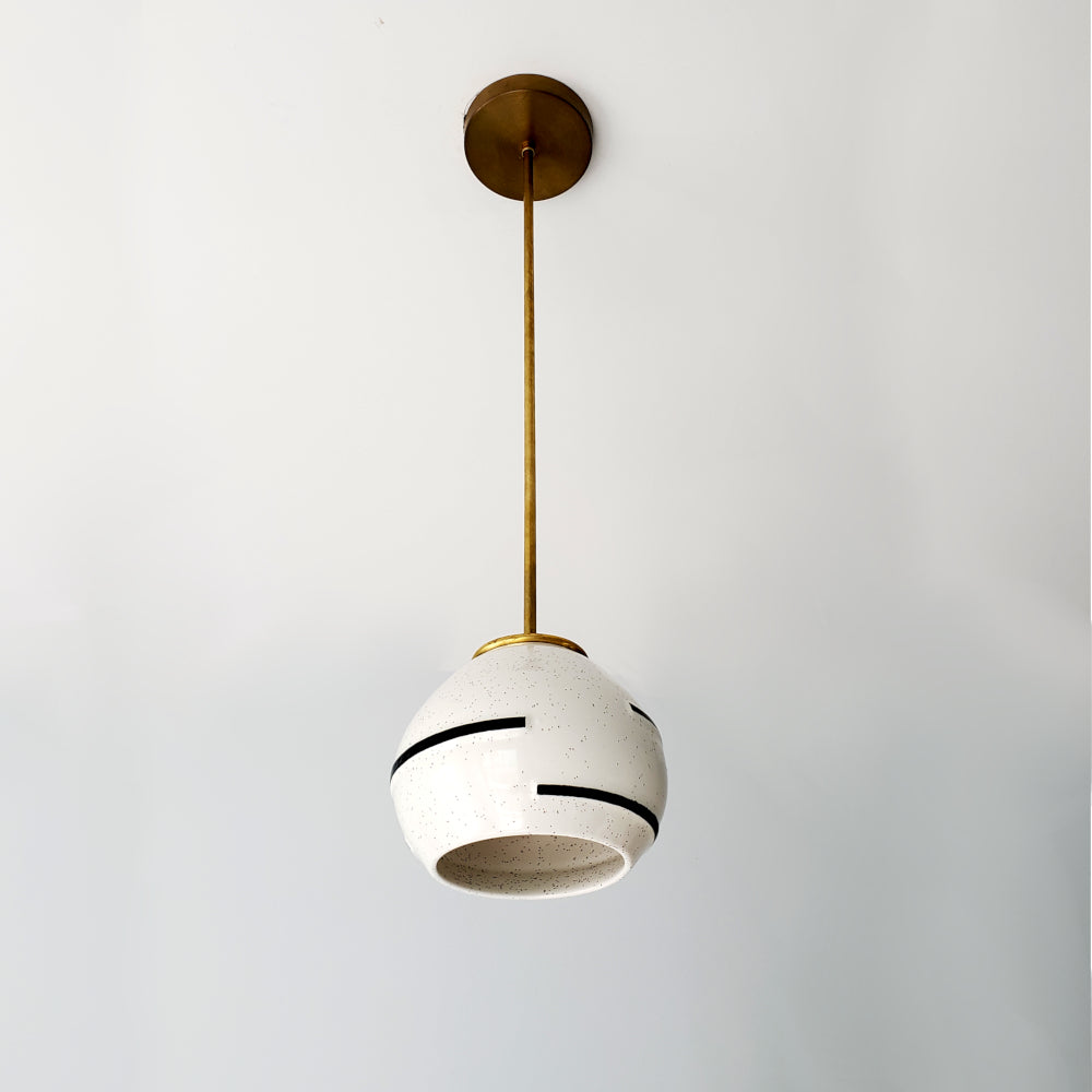 Earthy modern organic ceramic pendant lighting inspired by inlaid terrazzo front view