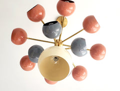 Solaris chandelier with coral grey and cream light shades mid century modern inspired southwestern colors