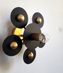 black and brass modern geometric circle sconce or flusmount fixture small glass lightbulb