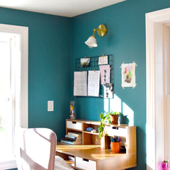 Teal Office Corner with a white and brass wall sconce