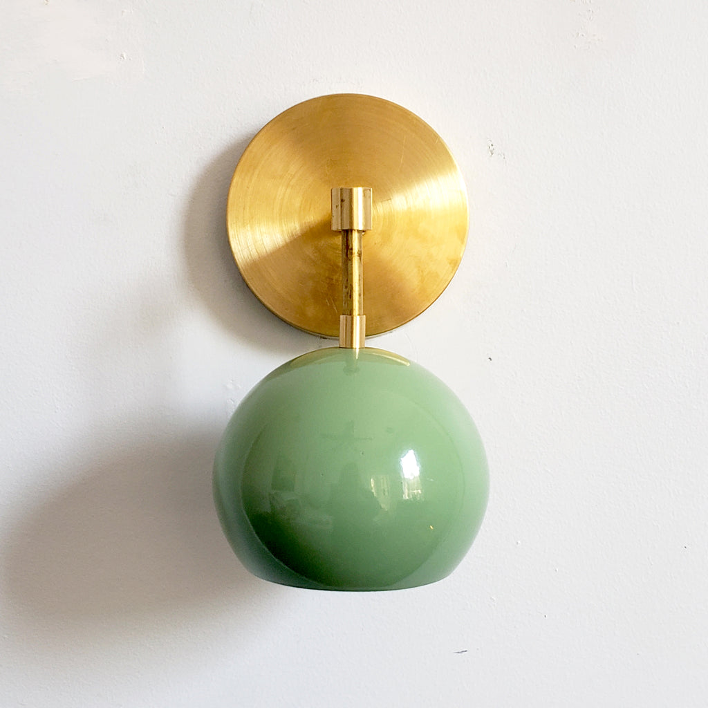 pale green and brass midcentury modern inspired globe wall lighting sconce