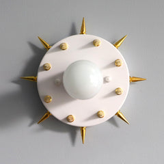 White and gold punk rock sconce