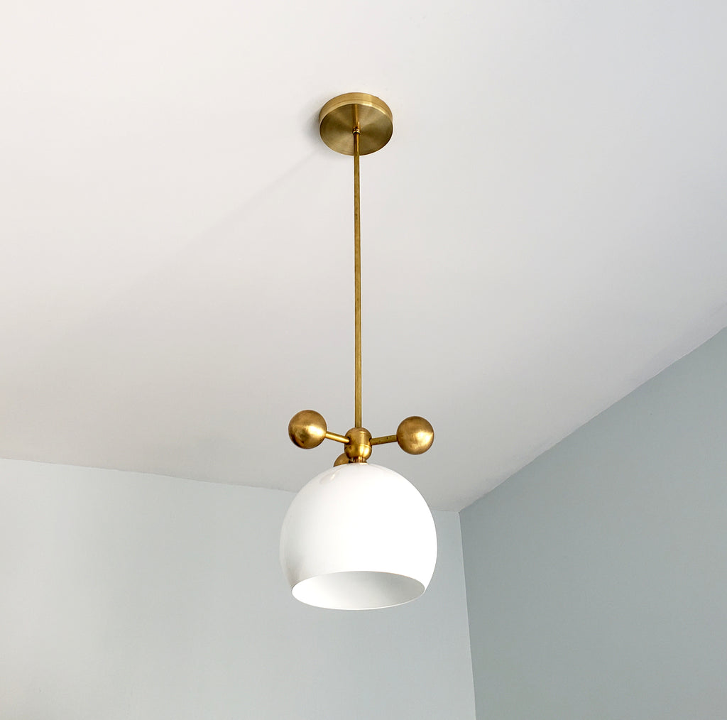 white and brass modern globe pendant with brass orb ball details midcentury inspired