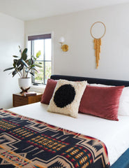 Boho Bedroom Design with articulating west end sconces