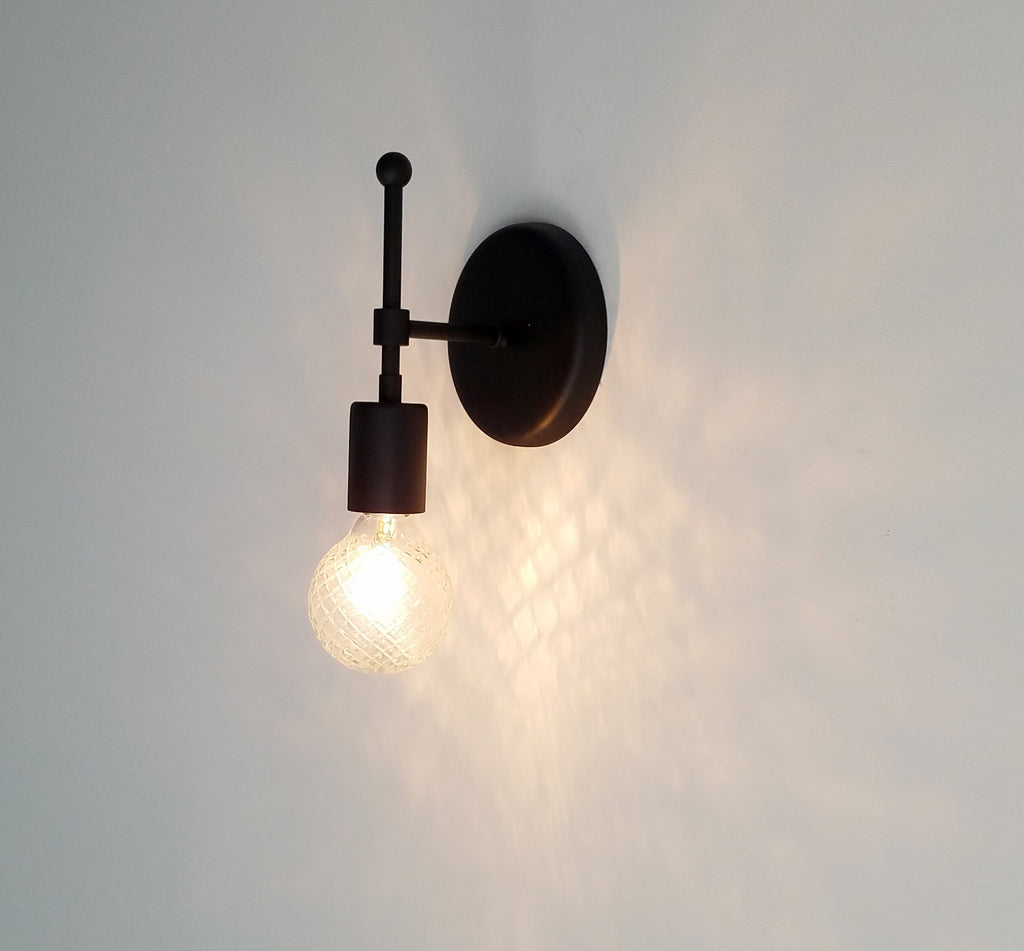 Camp sconce sazerac stitches matte black wall sconce bathroom lighting mozeypictures Gallery