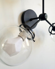 black and clear 3 light wall fixture modern